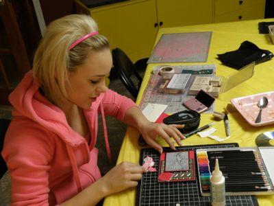 Renee making Woody's card