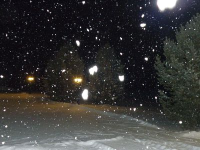 Snowing big white snow flakes